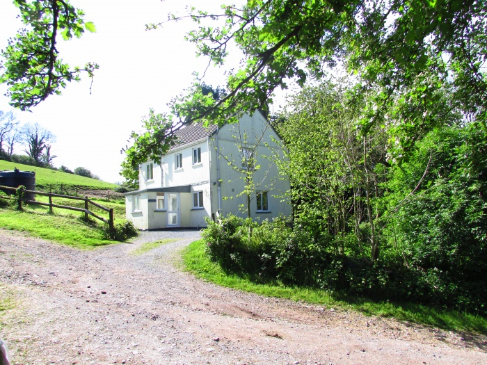Farmhouse with around 58.9 acres situated near the coastal town of Laugharne